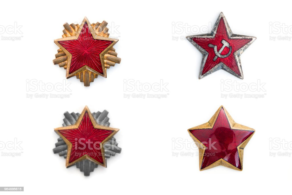 Old red stars from military caps isolated on the white background royalty-free stock photo