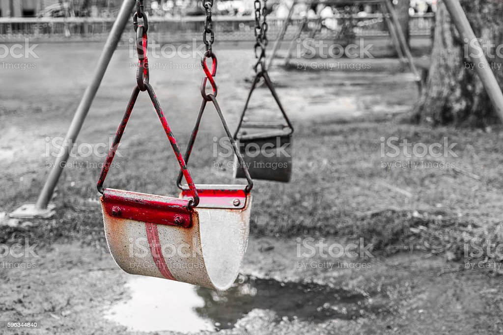 old red swing at playground royalty-free stock photo