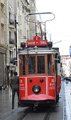 İstiklal Avenue, Istanbul, Turkey - April 28, 2019: The old tram, as a tourist attraction, runs along İstiklal Avenue in the downtown of Istanbul