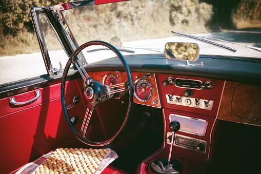 Cockpit of an old red vintage cabriolet sport car