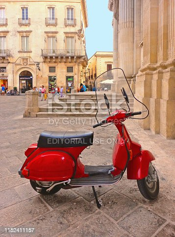 29.08.2015. Old red vintage motorcycle Vespa Piaggio on the street in downtown city Lecce, Salento Puglia in South Italy