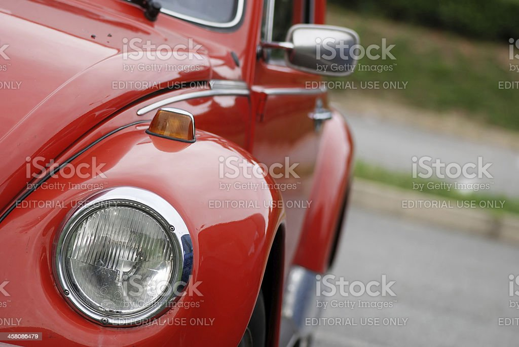 Old red Volkswagen Beetle in the street royalty-free stock photo
