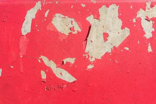 Concrete wall background with peeling red paint. Ideal for your presentations.