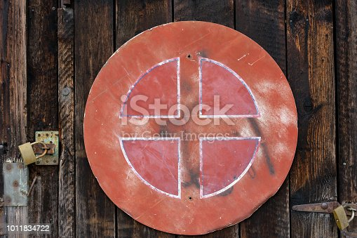 924754302istockphoto old red weathered street sign on wood wall 1011834722