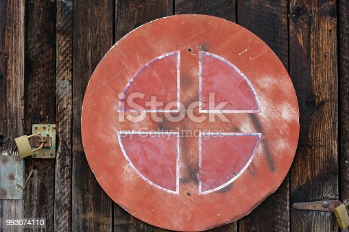 924754302istockphoto old red weathered street sign on wood wall 993074110