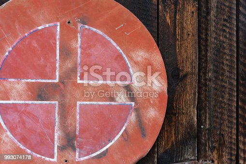 924754302istockphoto old red weathered street sign on wood wall 993074178