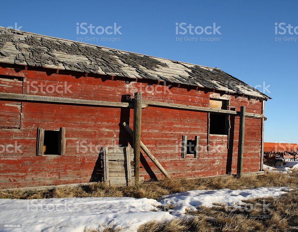 old red wooden grainery in winter royalty-free stock photo