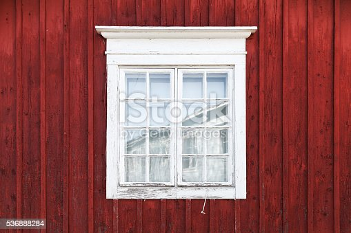 istock Old red wooden wall with window 536888284