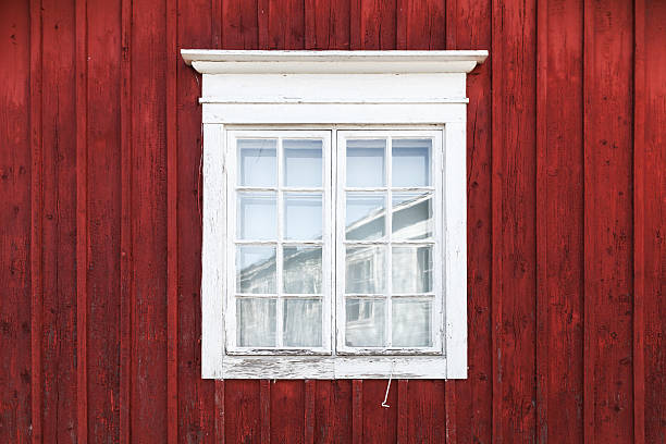 Old red wooden wall with window stock photo