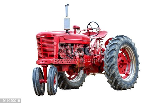 Horizontal shot of an old red work tractor isolated on a white background.