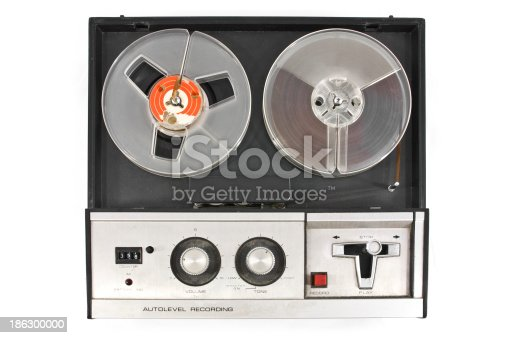 Old and obsolete reel tape recorder top view isolated on white background.