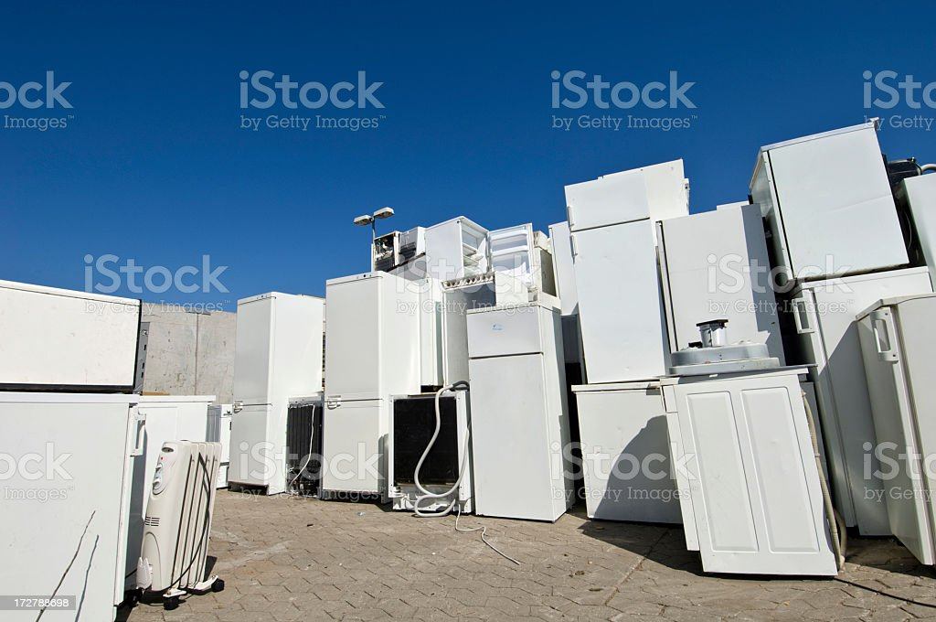 Old Refrigerators Waiting to Be  Scrapped At a Recycling Center royalty-free stock photo