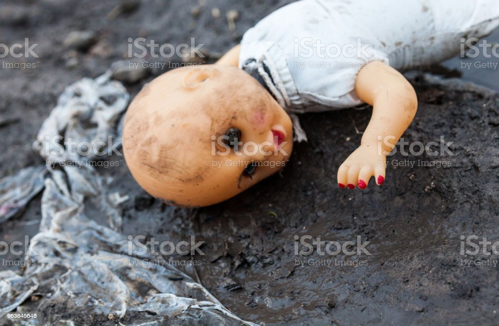 Old rejected dirty doll on the landfill - Royalty-free Abortion Stock Photo