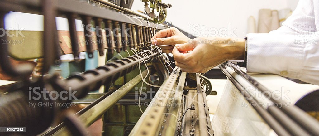Old relic of a stitching machine in a publishing company stock photo
