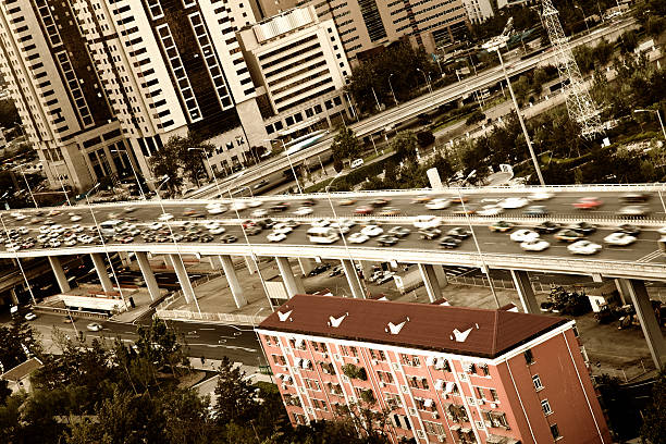 Old residential building along noisy highway in Beijing business dristrict stock photo