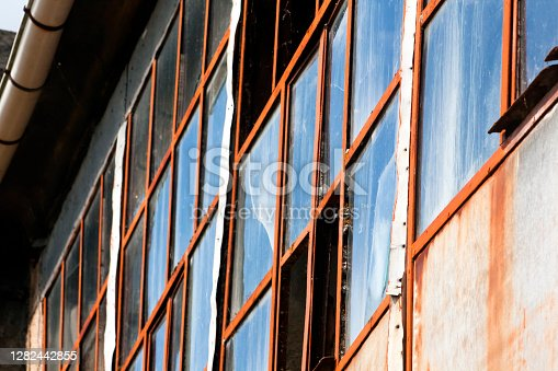 istock Old residential building, partially ruined galería and broken glasses. 1282442855