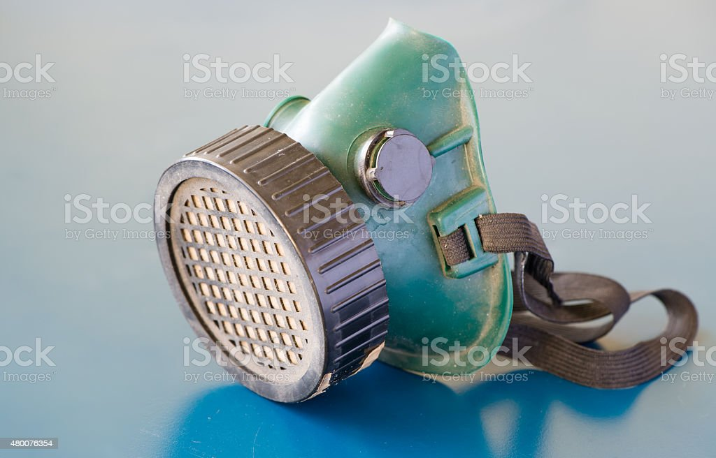 old Respiratory Protection on blue background stock photo