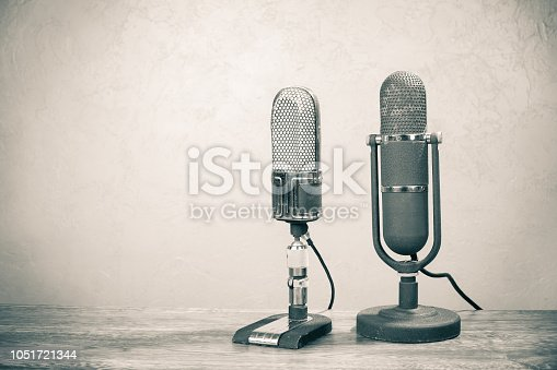 1065736660 istock photo Old retro big ribbon microphones from 50s on table. Vintage style sepia photo 1051721344