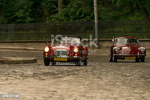 Lviv, Ukraine - June 3, 2018:Old retro car MGA 1500 & Porsche 356 B with its owner and an unknown passenger taking participation in race Leopolis grand prix 2018, Ukraine.