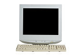 istock Old retro CRT monitor display with a keyboard isolated on white background. 1191389703