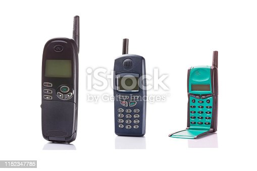 Old retro mobile phones isolated on white background.