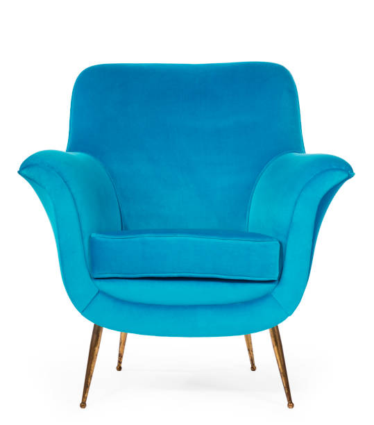 Old retro sixties style chair in blue Old antique sixties retro arm chair in blue upholstery armchair stock pictures, royalty-free photos & images