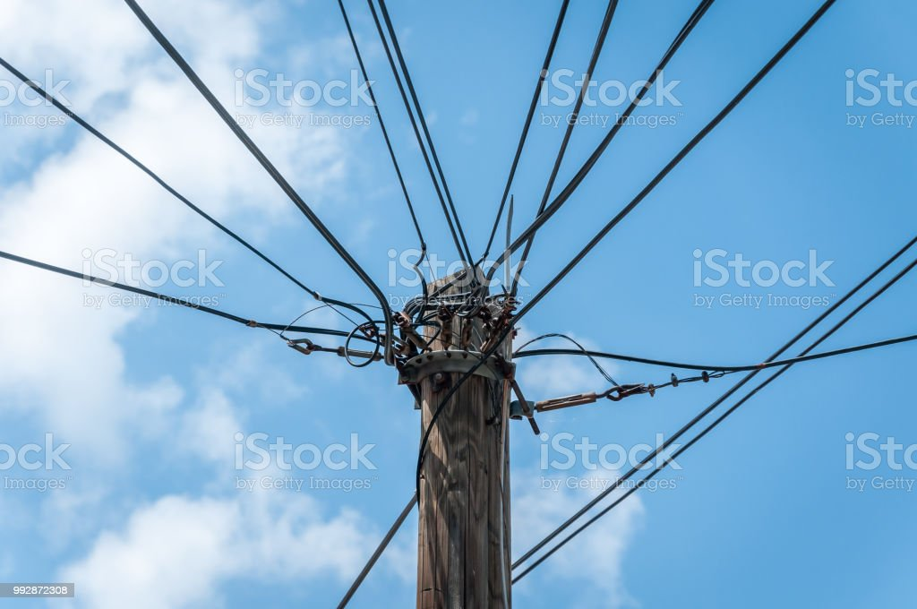 Old Retro Style Wooden Pole With Many Electric Supply Wires Or ...