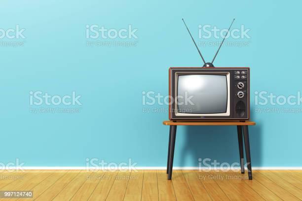 Old retro tv against blue vintage wall in the room picture id997124740?b=1&k=6&m=997124740&s=612x612&h=fvwq wt0ambrnzuzqhrmmxe7dbj6y824lhypgbupiuc=
