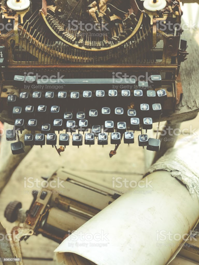 Old retro unnecessary faulty typewriter, professional writer...