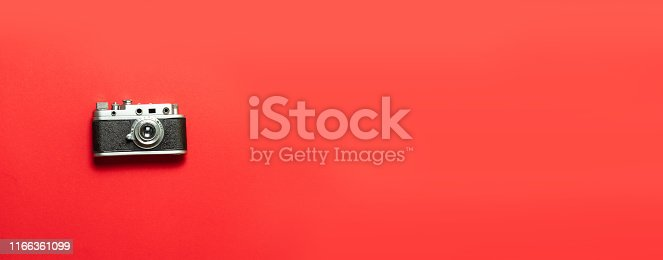 istock Old retro vintage camera on red background top view flat lay with copy space. 1166361099
