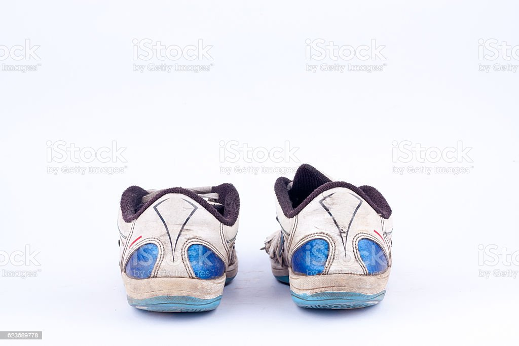 Old retro worn out futsal sports shoes  on white background stock photo