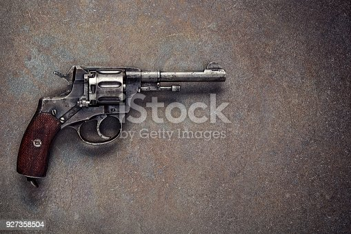 istock Old revolver on a dark background. 927358504