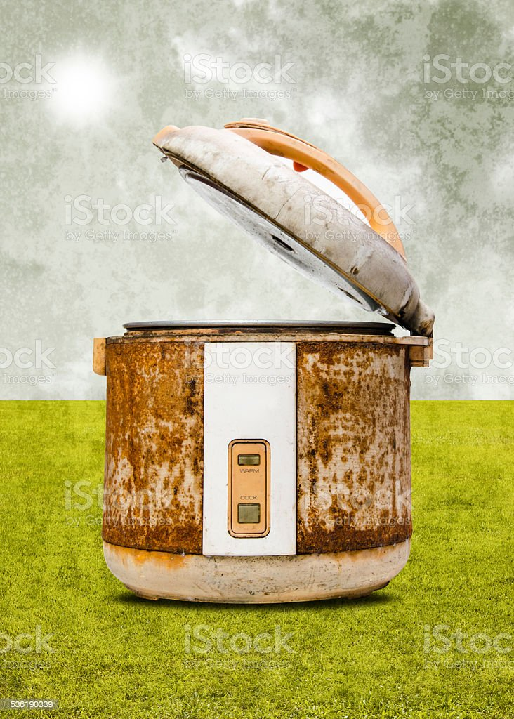 Old rice Cooker with nice garden and sky background stock photo