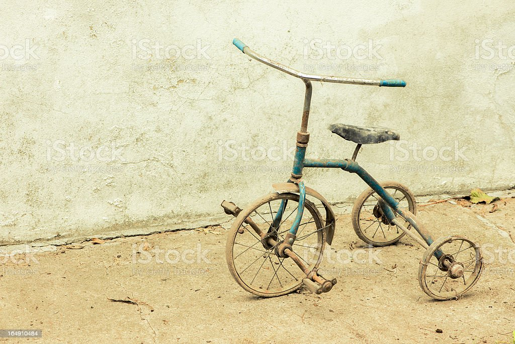 Old Rickety Tricycle stock photo