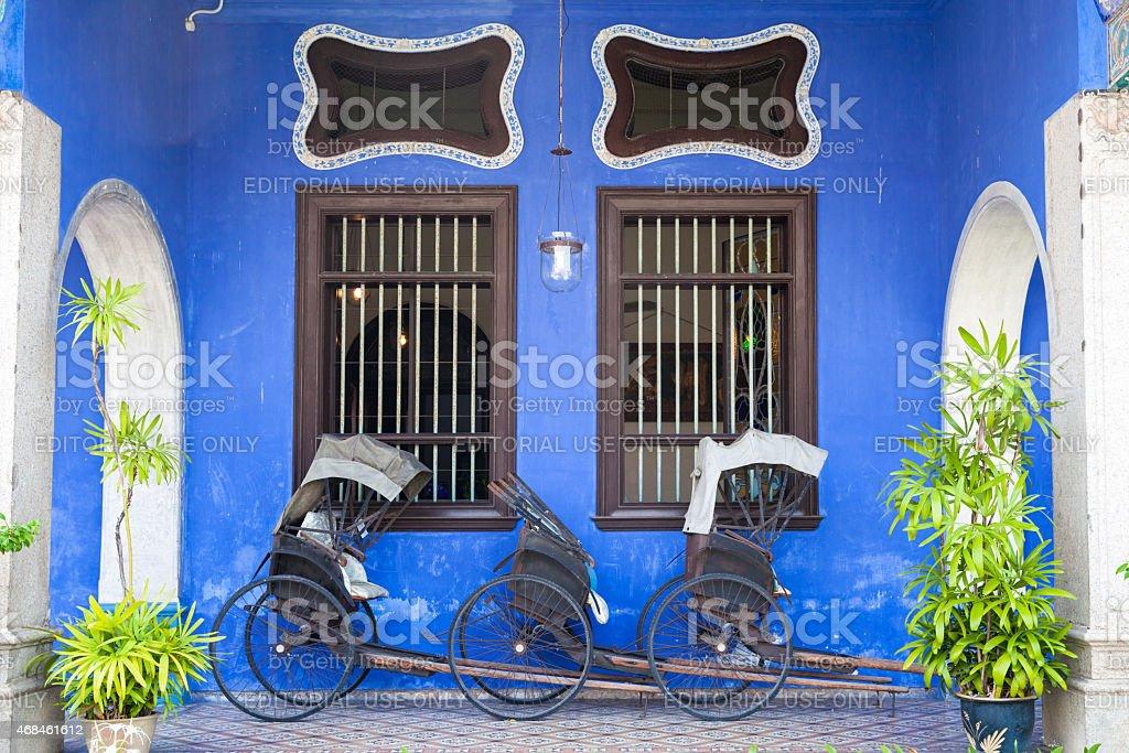 Old rickshaw tricycle near Fatt Tze Mansion or Blue Mansion, Penang stock photo
