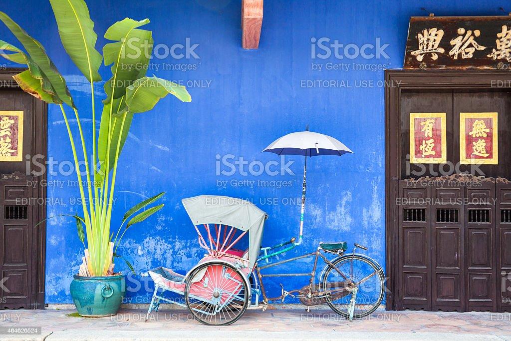Old rickshaw tricycle near Fatt Tze Mansion, Penang, Malaysia. royalty-free stock photo
