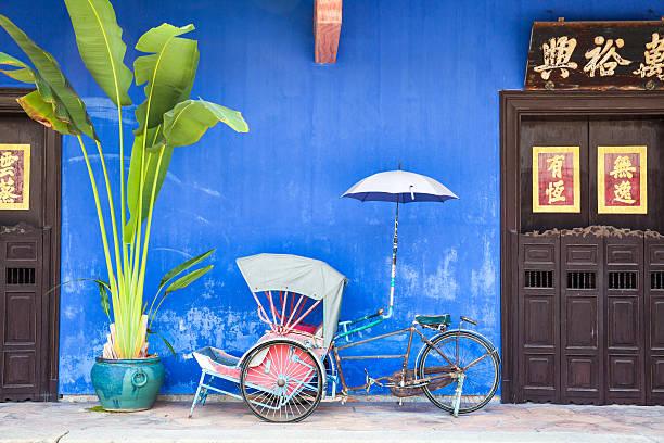 Old rickshaw tricycle near Fatt Tze Mansion, Penang, Malaysia. stock photo