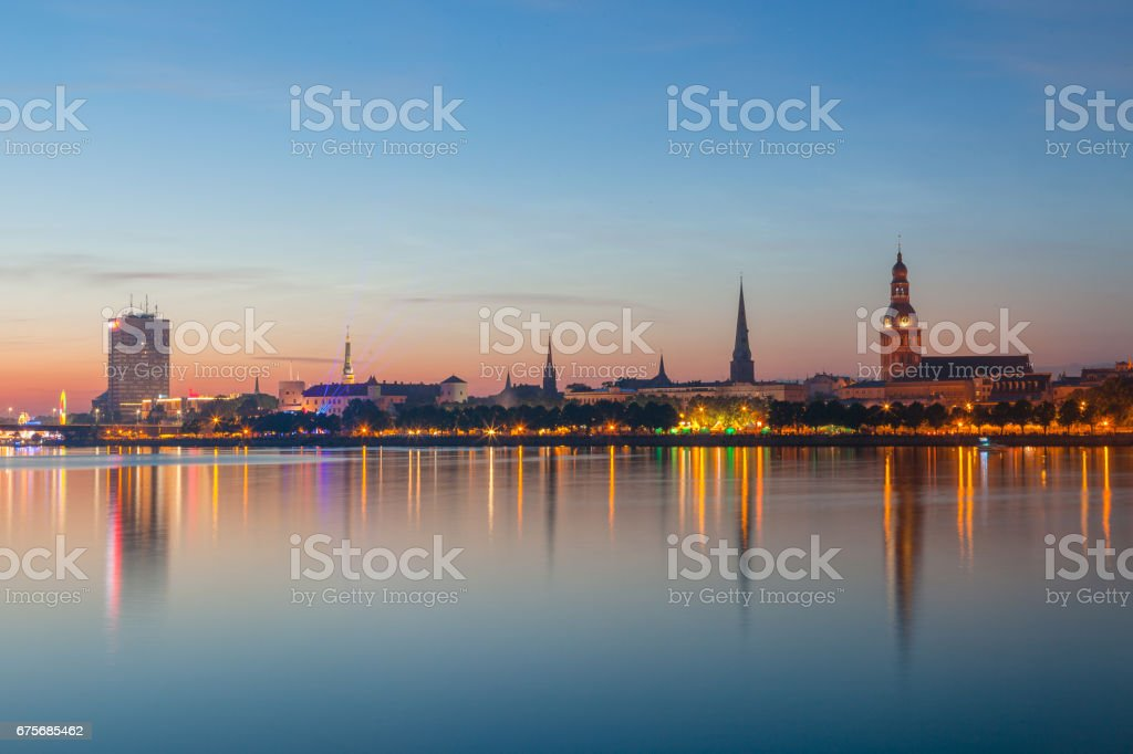 Old Riga night skyline. Illuminated city after sunset. Panoramic view over Daugava river royalty-free stock photo