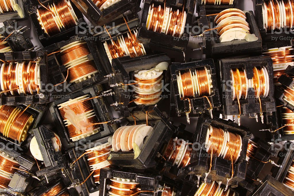 Old ring core transformers and coils stock photo