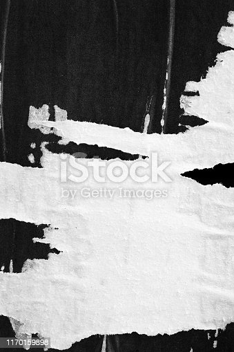 1087065964 istock photo Old ripped torn paper crumpled creased posters grunge textures backdrop surface backgrounds placard Black and White stock photo 1170159898