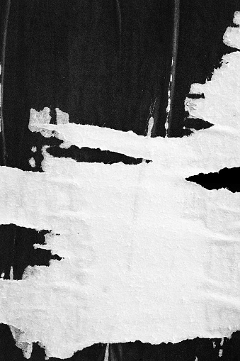 Old ripped torn paper crumpled creased posters grunge textures backdrop surface backgrounds placard Black and White stock photo