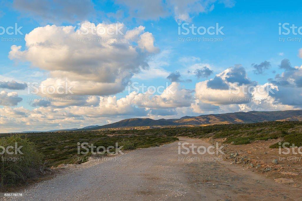 Old road leading along the coast of the Mediterranean Sea stock photo