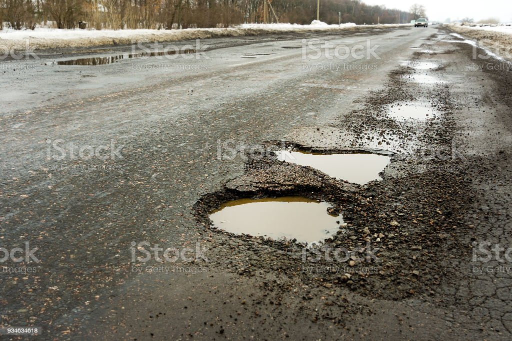 old road  potholes holes outside city autumn weather HDR royalty-free stock photo