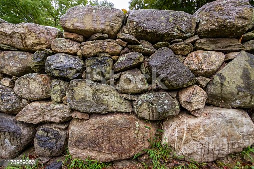 Close up of old rock wall boundary in New England Connecticut