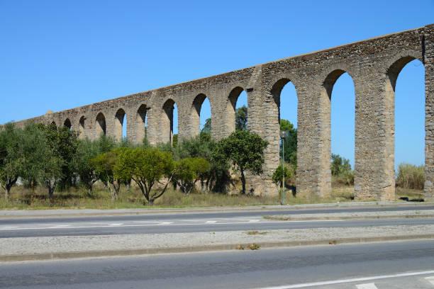Old Roman aqueduct, City of Evora, Portugal stock photo