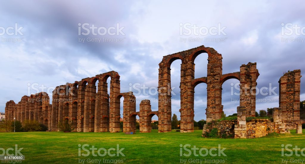 old roman aqueduct in  twilight lights. Merida stock photo