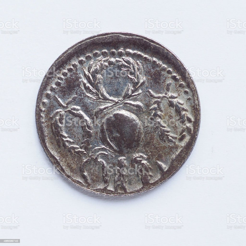 Old Roman coin stock photo
