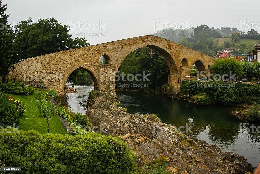Old Roman stone bridge in Cangas de Onis in Asturias stock photo