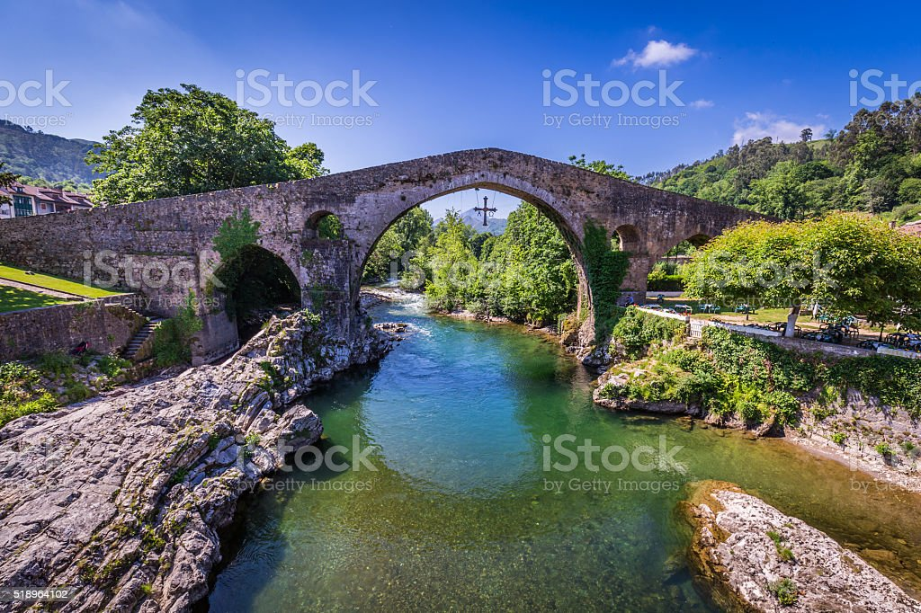 Old Roman stone bridge in Cangas de Onis (Asturias), Spain stock photo