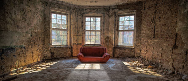 old room with a couch - dilapidated stock pictures, royalty-free photos & images